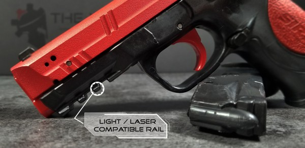 SIRT laser training pistol close up view of light/laser compatible rail