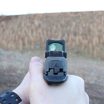 Shooting through a Trijicon RMR at a steel target